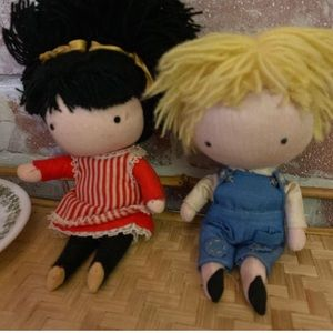 "2 adorable dolls ""pocket pals"" dated '69 and '70"